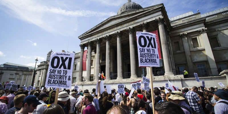 An anti-austerity demonstrators attend a rally in Trafalgar Square in central London on July 4, 2015 in solidarity with those voting 'No' in Greece's forthcoming referendum. Greece braced itself Saturday ahead of a make-or-break bailout referendum as polls showed the 'Yes' and 'No' camps neck and neck and uncertainty rose over the future of the country's battered economy. AFP PHOTO / JACK TAYLOR        (Photo credit should read JACK TAYLOR/AFP/Getty Images)