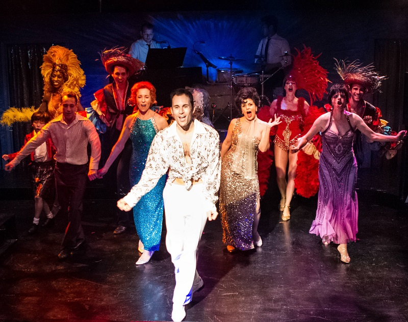 Andrew Bongiorno (center) as Peter Allen in the Celebration Theatre's West Coast premiere of The Boy from Oz,  directed by Michael A. Shepperd  at the Lex Theatre (photo by Casey Kringlen)