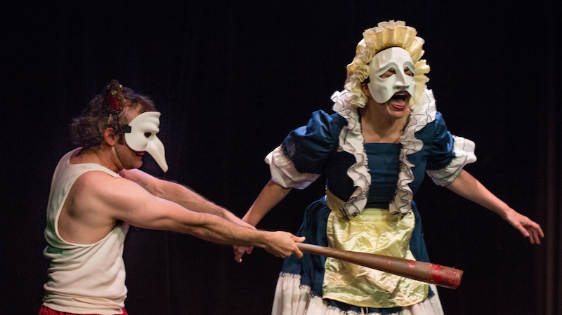 Jimmy Slonina slaps Sondra Mayer with a very big stick in the live-action Punch and Judy (photo by Darrett Sanders)