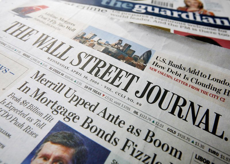 LONDON - APRIL 16:  A copy of the U.S. Edition of The Wall Street Journal on a copy of The Guardian, bith of which have been purchased at the same London newsagent on April 16, 2008 in London, England. It is the first day of the U.S Edition of the newspaper being on sale in U.K.  (Photo by Cate Gillon/Getty Images)