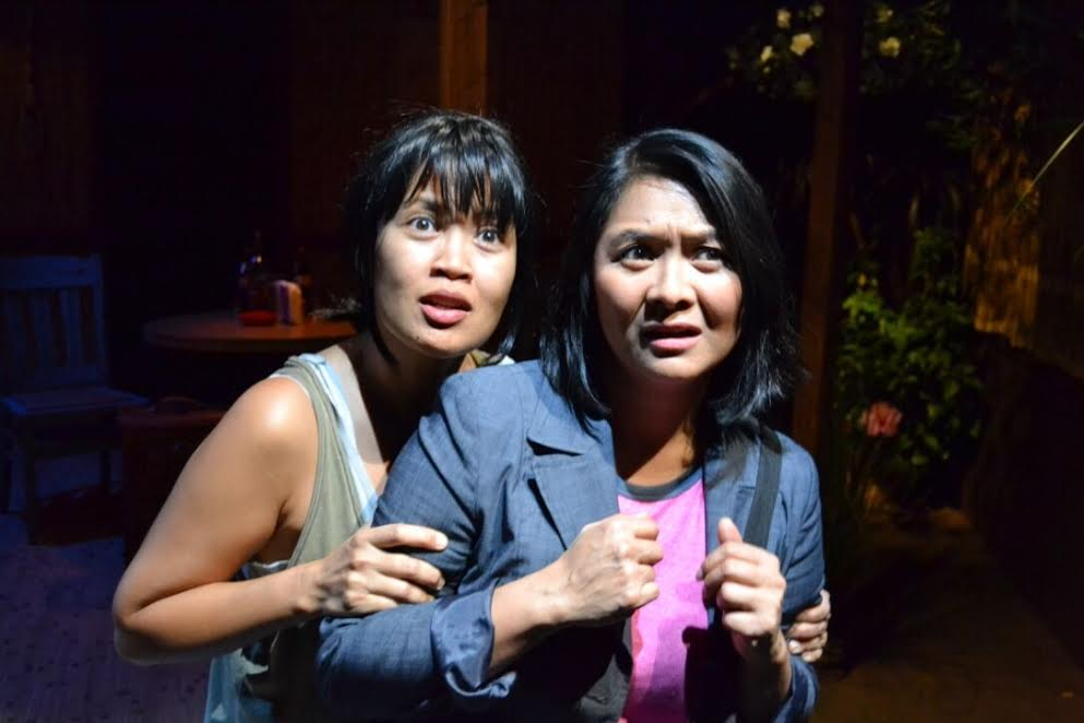 Evie Abat and Myra Cris Ocenar in Boni B. Alvarez's Bloodletting (photo courtesy Playwrights' Arena)