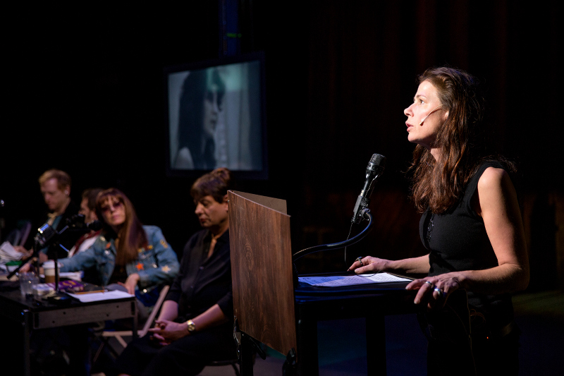 Maura Tierney (foreground) in The Wooster Group's The Town Hall Affair. (Photo by Steven Gunther)